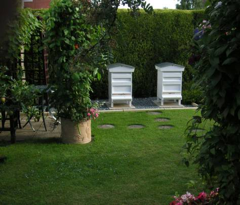 Exquisite white National-style hives in the UK