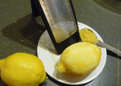 Grater and lemons with zest